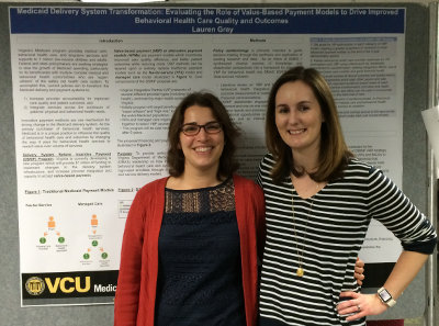 Lauren Gray and Dr. Mezuk in front of Lauren's poster